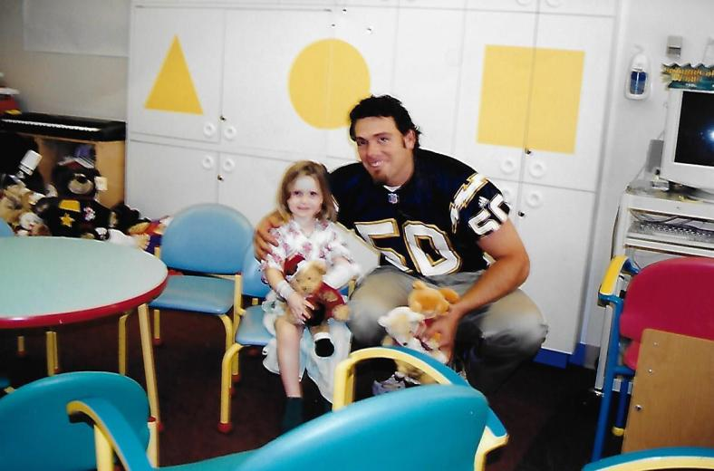 Cassie with Charger Player in hospital